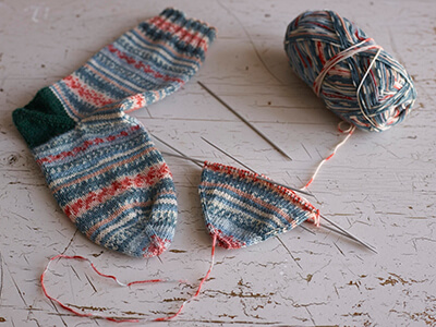 Learn how to knit socks with Arne & Carlos